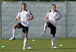 Germany's national soccer player Bender and Schweinsteiger warm-up during a training session in Gdansk